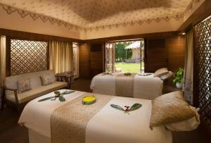 A bed or beds in a room at Jai Mahal Palace