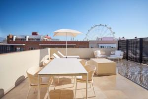 A balcony or terrace at Tandem Soho Suites