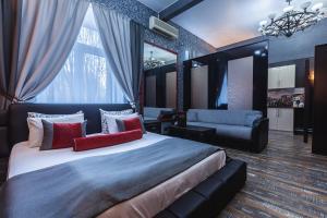 Кровать или кровати в номере Везендорф Алексеевская