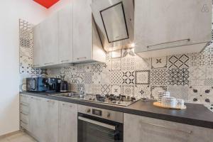 A kitchen or kitchenette at Sara's SeaView Apartment