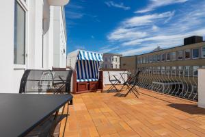 Ein Balkon oder eine Terrasse in der Unterkunft Logierhaus am Rathaus