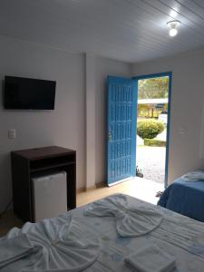 Cama ou camas em um quarto em Pousada Recanto Alpino