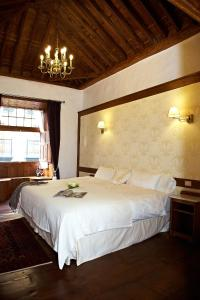 A bed or beds in a room at Hotel Emblemático San Agustin