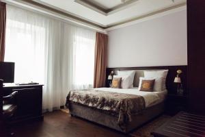 Кровать или кровати в номере Бутик Отель Меншиков