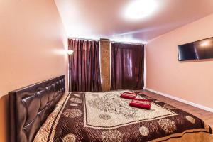 Кровать или кровати в номере Apart Сenter Nevsky