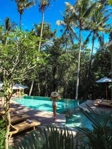 The swimming pool at or near Adiwana Arkara Villa