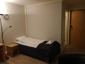 Un ou plusieurs lits dans un hébergement de l'établissement Tana Hotel & Camping