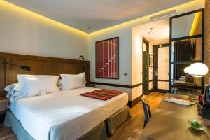 A bed or beds in a room at Only YOU Hotel Atocha