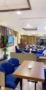 Um restaurante ou outro lugar para comer em Swiss Blue Al Samer