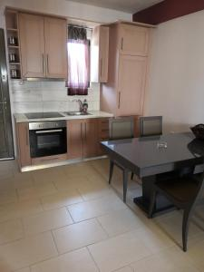 A kitchen or kitchenette at Naiades Villas