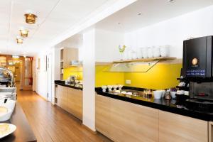A kitchen or kitchenette at Good Morning+ Sundsvall