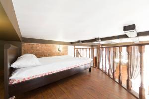 Кровать или кровати в номере Апартаменты 12