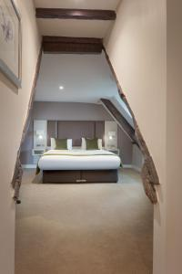 A bed or beds in a room at Mercure Shrewsbury Albrighton Hall Hotel & Spa