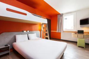A bed or beds in a room at ibis budget Paris Porte de Vincennes