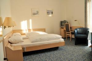 Кровать или кровати в номере Central Hotel