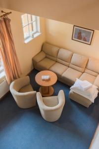 Ein Sitzbereich in der Unterkunft Vila Flora