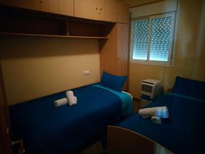 Cama o camas de una habitación en Home&Holidays Las Gabias, Granada