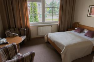 Ein Bett oder Betten in einem Zimmer der Unterkunft Vila Flora