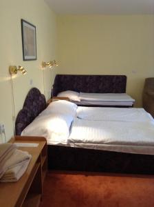 Postel nebo postele na pokoji v ubytování Hotel YORK