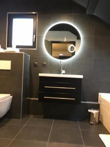 Ванная комната в Hotel Restaurant au Floridor