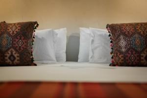 Letto o letti in una camera di The Riad - Adults Only