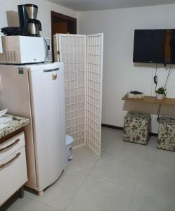 A television and/or entertainment centre at Flat Praia do Forte