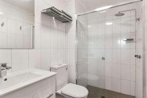 A bathroom at Quality Inn Carriage House
