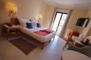 Cama o camas de una habitación en Hotel Calypso