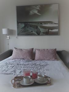 Een bed of bedden in een kamer bij StudioWestdiep