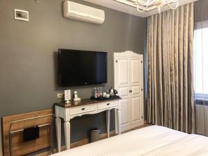 تلفاز و/أو أجهزة ترفيهية في فندق ماي دورا