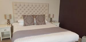 A bed or beds in a room at Dower House Hotel; Sure Hotel Collection by Best Western