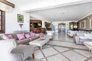 A seating area at Ship Inn Boutique Hotel & SPA & Restaurant near the beach