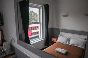 A bed or beds in a room at Hotel 261
