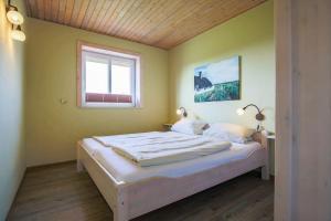 Ein Bett oder Betten in einem Zimmer der Unterkunft Büdlfarm - Haus