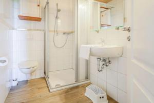 Ein Badezimmer in der Unterkunft Büdlfarm - Haus