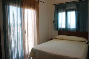 Кровать или кровати в номере Kalntera