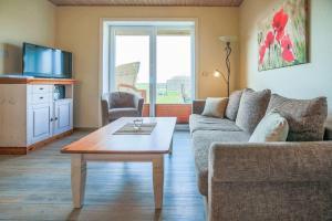 Ein Sitzbereich in der Unterkunft Büdlfarm - Haus