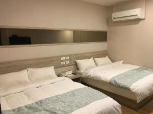 A bed or beds in a room at Boutique HOTEL
