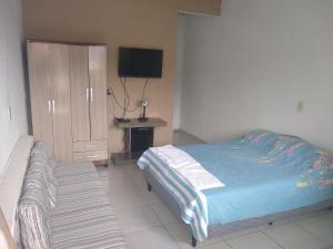 A bed or beds in a room at Venha Para Angra - Loft Amplo