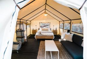 A bed or beds in a room at AutoCamp Yosemite