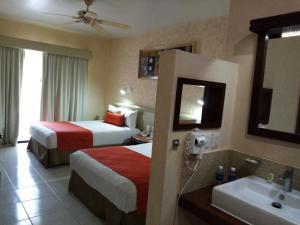 Cama o camas de una habitación en Olas Altas Inn Hotel & Spa