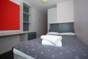 A bed or beds in a room at Beaverbank Place - Campus Residence