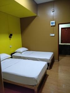 Ein Bett oder Betten in einem Zimmer der Unterkunft Galaxy Motel Hpa-An