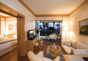 A seating area at Constantinou Bros Asimina Suites Hotel