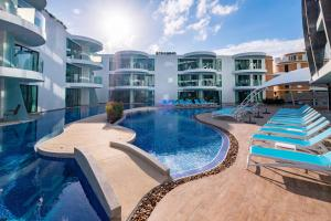 The swimming pool at or near Absolute Twin Sands Resort & Spa - SHA Plus