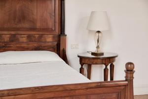 Ein Bett oder Betten in einem Zimmer der Unterkunft Palazzo Contarini Della Porta Di Ferro
