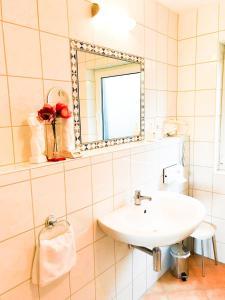Ein Badezimmer in der Unterkunft Landhotel Gärtner