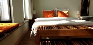 A bed or beds in a room at Bed & Breakfast Exterlaer