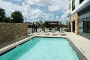 The swimming pool at or near Fairfield Inn & Suites by Marriott Houston Pasadena
