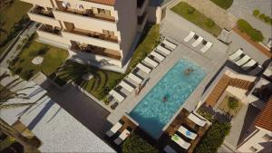 A view of the pool at Villa Royal or nearby